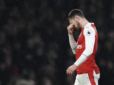 Arsenal's Aaron Ramsey looks dejected as he walks off to be substituted after sustaining an injury. Reuters