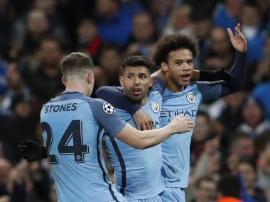 Manchester City's Sergio Aguero celebrates scoring their third goal with teammates. Reuters
