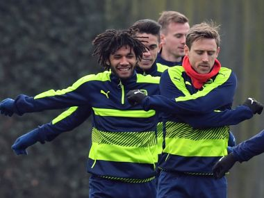 Arsenal players take part in a training session ahead of their Champions League clash against Bayern. AFP