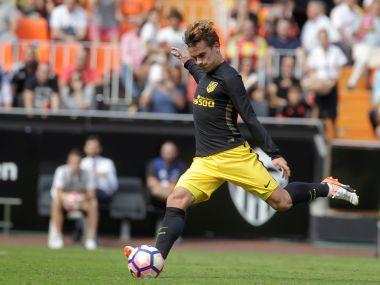 Atletico Madrid's Antoine Griezmann kicks a penalty. Reuters