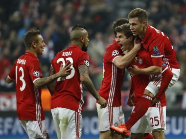 Bayern Munich's Thomas Mueller celebrates scoring with his teammates. AFP