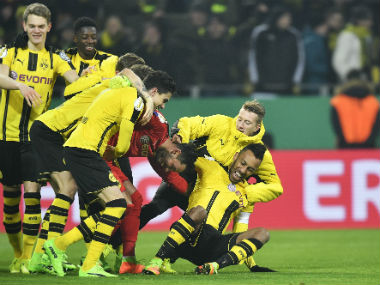 Borussia Dortmund players celebrate after winning against Hertha Berlin on penalties. AP
