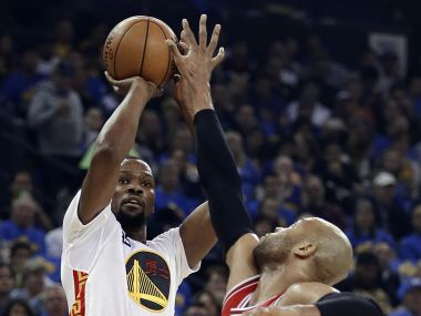 Golden State Warriors' Kevin Durant shoots over Chicago Bulls forward Taj Gibson. AP