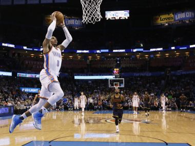 Oklahoma City Thunder guard Russell Westbrook goes up for an unopposed dunk against the Cleveland Cavaliers. AP