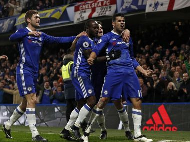 Chelsea's striker Diego Costa (R) celebrates with teammates after scoring. AFP
