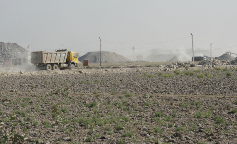 Stone mining and quarrying industry and dust have virtually turned agricultural fields into 'barren land'. Firstpost/Debobrat Ghose