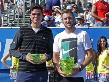 Milos Raonic, left, and Jack Sock, right, pose with their trophies. AP