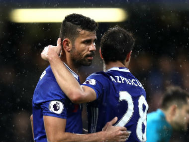 Diego Costa celebrates after scoring the third goal for league leaders Chelsea in their match against Swansea. Getty Images