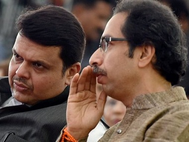 Devendra Fadnavis and Uddhav Thackeray. PTI