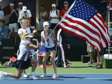 CoCo Vandeweghe flexes her muscles while celebrating with USA Fed Cup teammates Alison Riske and Shelby Rogers. AP