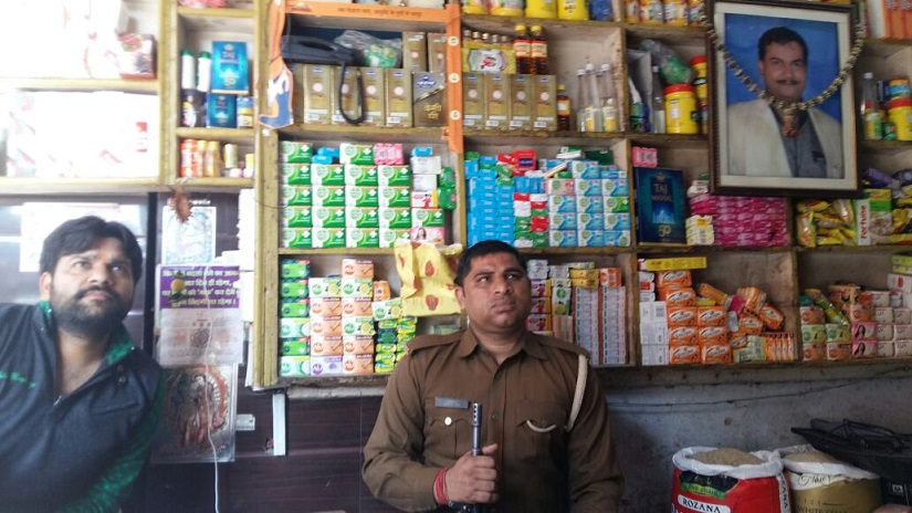 Hindu businessman Varun Singhal is provided with armed security to run his kirana store at Begumpura Bazar in Kairana, India. Firstpost/Tufail Ahmad