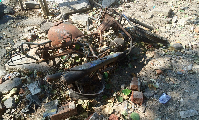 Burnt bikes are still scattered across what was the old fish market. Divya Karthikeyan
