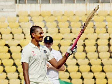 :India U-19 batsman Daryl S Ferrario raises his bat celebrates his century against England during the Test match at VCA stadium in Nagpur on Wednesday. PTI