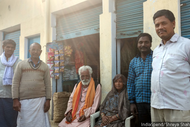 """Iklakh Ahmed, second from the right, said he will move his daughter from the government school in Fattepur village, Mirzapur district, to a private school. """"Children don't learn much in the government school,"""" he said."""