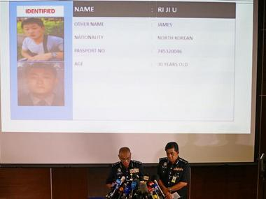 Malaysian Police Officers speak in front of a screen showing North Korean suspect Ri Ji U during a news conference regarding the apparent assassination of Kim Jong Nam, the half-brother of the North Korean leader. Reuters