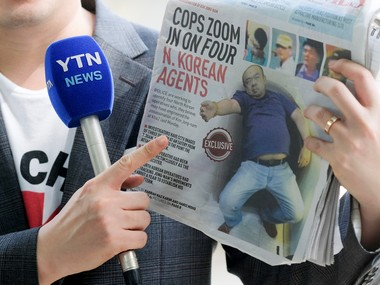 A reporter holds up a local newspaper during his report in front of the morgue at Kuala Lumpur General Hospital where Kim Jong Nam's body is held for autopsy in Malaysia . Reuters