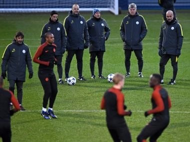 Manchester City's Pep Guardiola and players during a training session. AFP