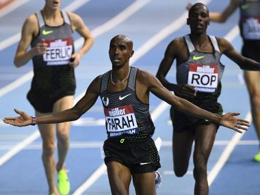 Mo Farah wins the 5000m final during the indoor athletics Grand Prix in Birmingham. AFP
