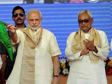 Narendra Modi and Nitish Kumar. PTI
