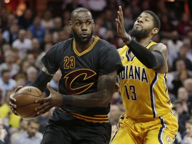 Cleveland Cavaliers LeBron James drives against Indiana Pacers' Paul George. AP