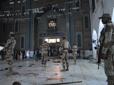 Pakistani para-military soldiers at the shrine of Sufi Lal Shahbaz Qalandar in Pakistan. AP