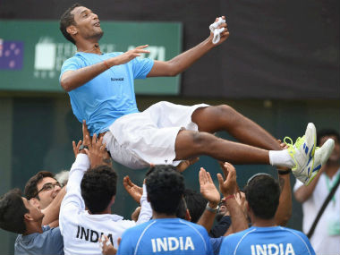 Team mates throw Ramkumar Ramanathan in the air after his win over Finn Tearney. PTI