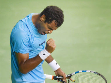 Ramkumar Ramanathan reacts after winning a point. PTI