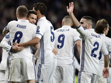 Real Madrid's teammates celebrate their third goal vs SSC Napoli in the Champions League. AFP