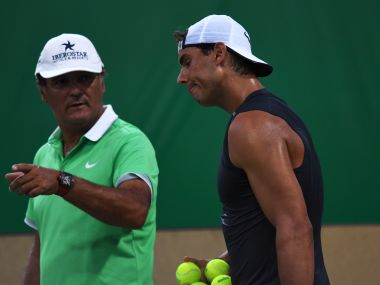 File photo of Rafael Nadal with his coach and uncle Toni Nadal. AFP