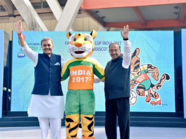 Vijay Goel and Praful Patel with the official mascot for the U17 World Cup. Twitter: @VijayGoelBJP