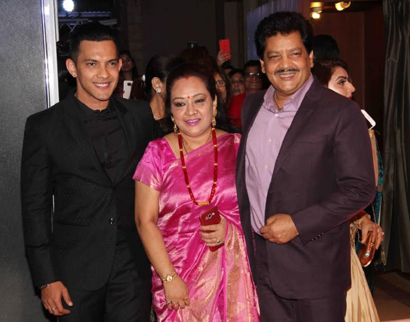 Bollywood singer Aditya Narayan along with his father Udit Narayan and mother during the wedding reception of Bollywood actor Neil Nitin Mukesh in Mumbai, India on February 17, 2017. (Utsav Devdutta/SOLARIS IMAGES