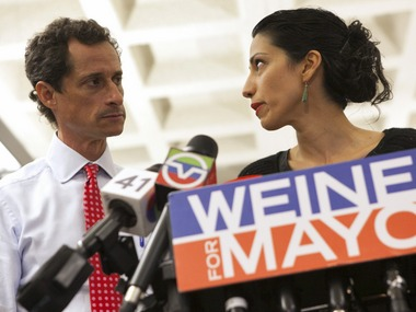 File photo of Anthony Weiner and Huma Abedin. Reuters