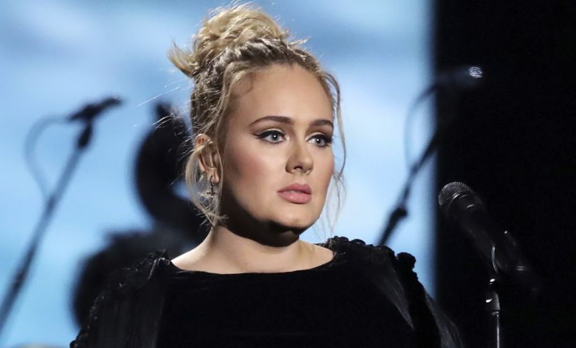 Adele performed a tribute to George Michael at the 59th annual Grammy awards.
