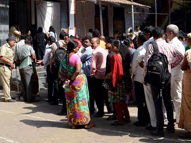 Voters queue up at a polling booth in Mumbai
