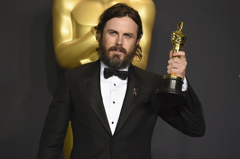 """Casey Affleck poses in the press room with the award for best actor in a leading role for """"Manchester by the Sea"""" at the Oscars on Sunday, Feb. 26, 2017, at the Dolby Theatre in Los Angeles. (Photo by Jordan Strauss/Invision/AP)"""