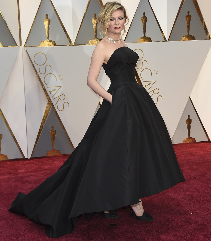 Kirsten Dunst arrives at the Oscars on Sunday, Feb. 26, 2017, at the Dolby Theatre in Los Angeles. (Photo by Jordan Strauss/Invision/AP)