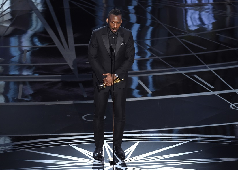 """Mahershala Ali accepts the award for best actor in a supporting role for """"Moonlight"""" at the Oscars on Sunday, Feb. 26, 2017, at the Dolby Theatre in Los Angeles. (Photo by Chris Pizzello/Invision/AP)"""