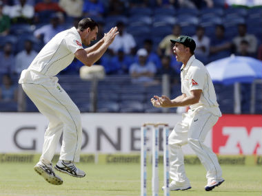 Starc, left and Handscomb celebrate the dismissal of India's captain Virat Kohli in the first Test at Pune. AP