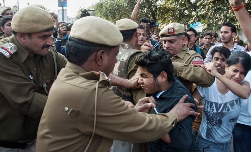 Students clash with police at Ramjas College in Delhi. PTI