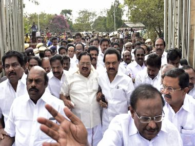 DMK leader MK Stalin arrives along with his party MLAs at State Secretariat on Saturday. PTI