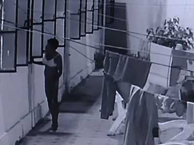 Screengrab of the footage showing the man sneaking into the women's hostel. Source: ANI