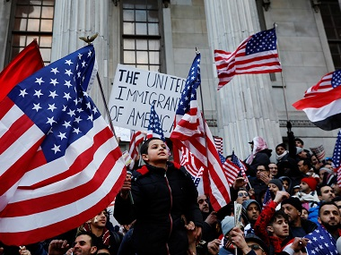 Demonstrators participate in a protest against US president Donald Trump's travel ban. Reuters