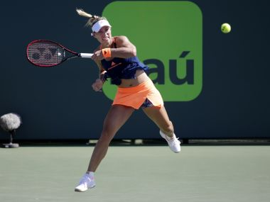 Angelique Kerber hits a return to Risa Ozaki during the Miami Open. Getty