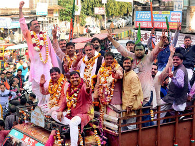 BJP candidates during a victory procession after their win in Assemby polls in Muzaffarnagar on Saturday. PTI