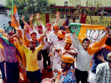 BJP party workers celebrate. PTI