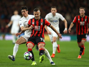 Jack Cork of Swansea City (left) and AFC Bournemouth's Jack Wilshere battle for possession. Getty Images