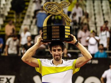 Pablo Cuevas with the Brazil Open trophy. Image courtesy: Twitter/@BrasilOpenTenis