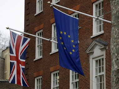 A European Union flag besides a British flag outside Europe House in London. AP
