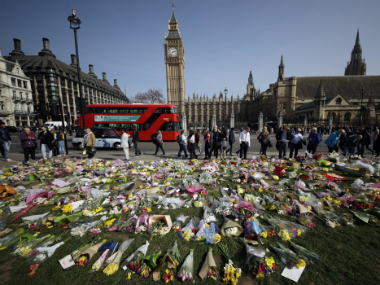 Floral tributes to the victims of the Westminster attack are placed outside the Palace of Westminster, London. AP