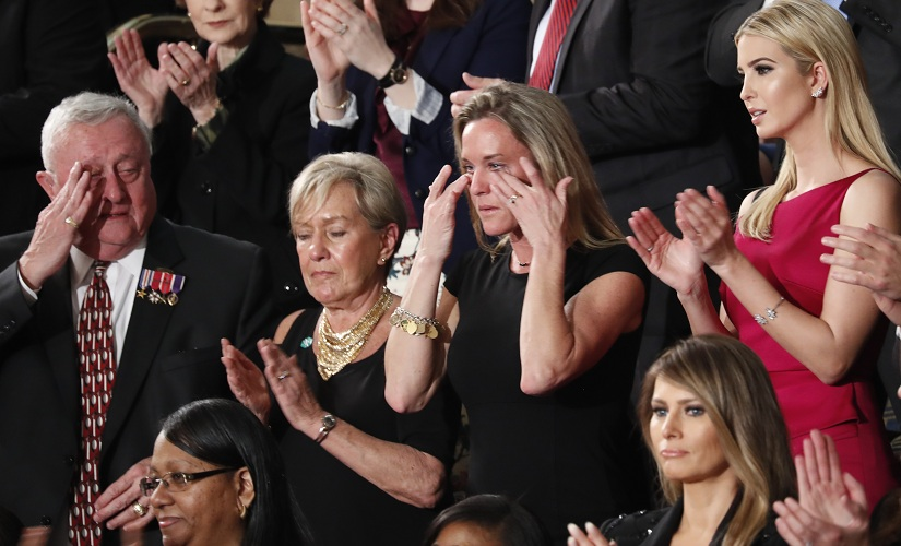 "Carryn Owens, widow of widow of Chief Special Warfare Operator William ""Ryan"" Owens, wipes her eyes on Capitol Hill in Washington on Tuesday. AP"